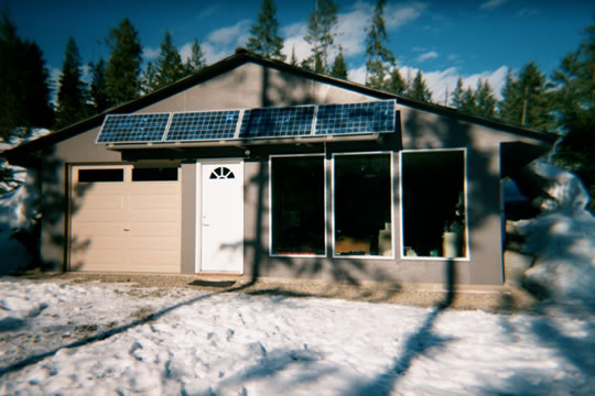 Earth sheltered, energy efficient, solar powered home